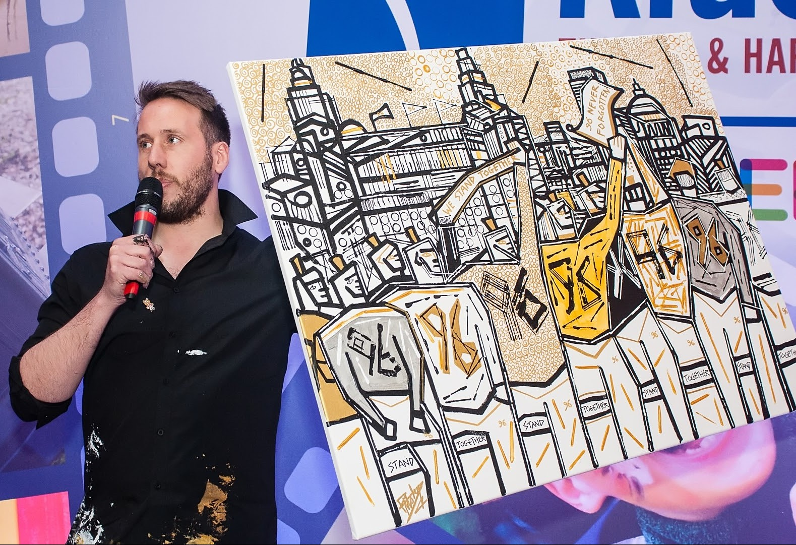 Artist Ben Moseley displays artwork he painted during the 2016 Liverpool event.