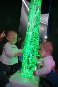 babies admiring light up bubble tube
