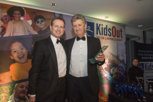 Event Chairman and KidsOut Trustee Chris Burton presents Osborne Clarke with the Bristol Company of the Year award